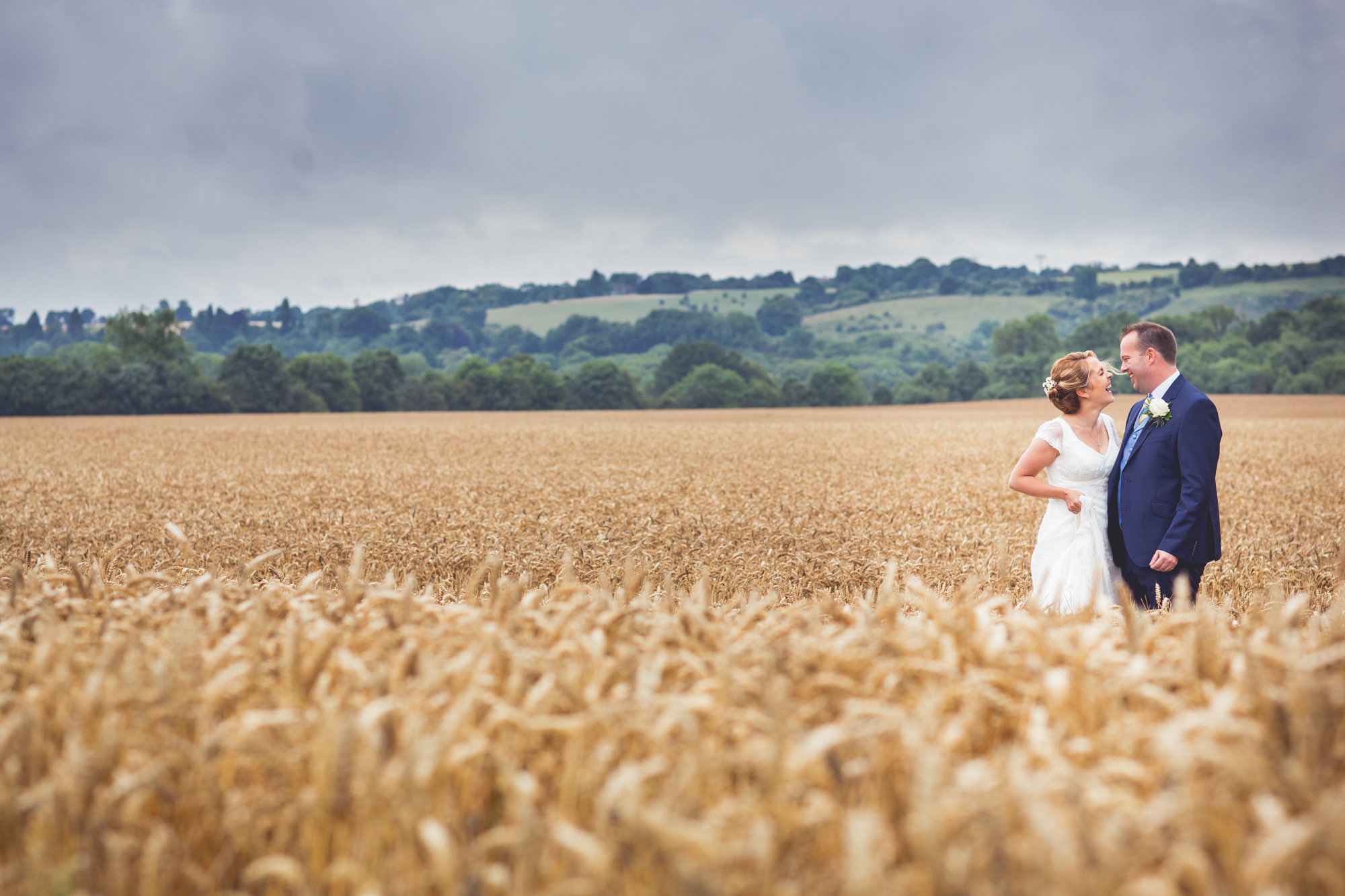 Bride and Groom portrait shot in a wheat field in the countryside.