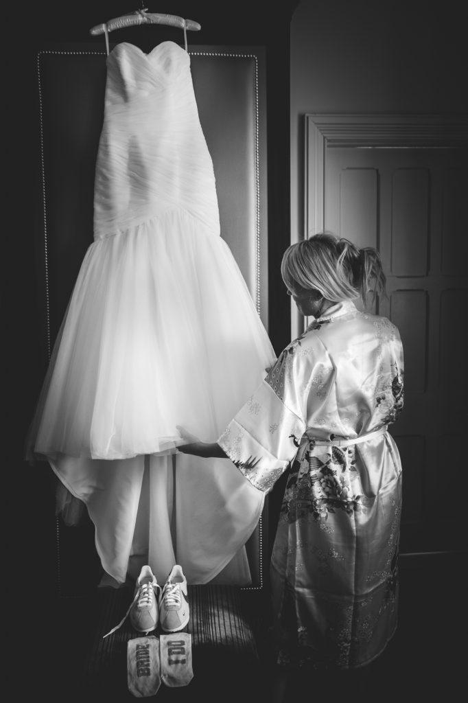 Wedding dress hanging up wedding prep photo