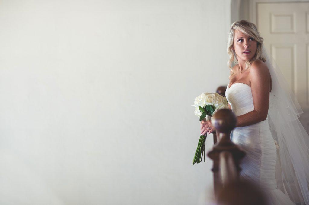 Bride at balcony in wedding dress