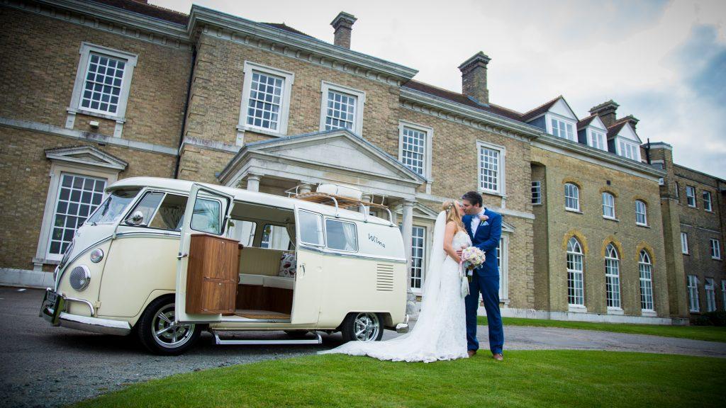 Bride and Groom portrait shot in front of camper van.