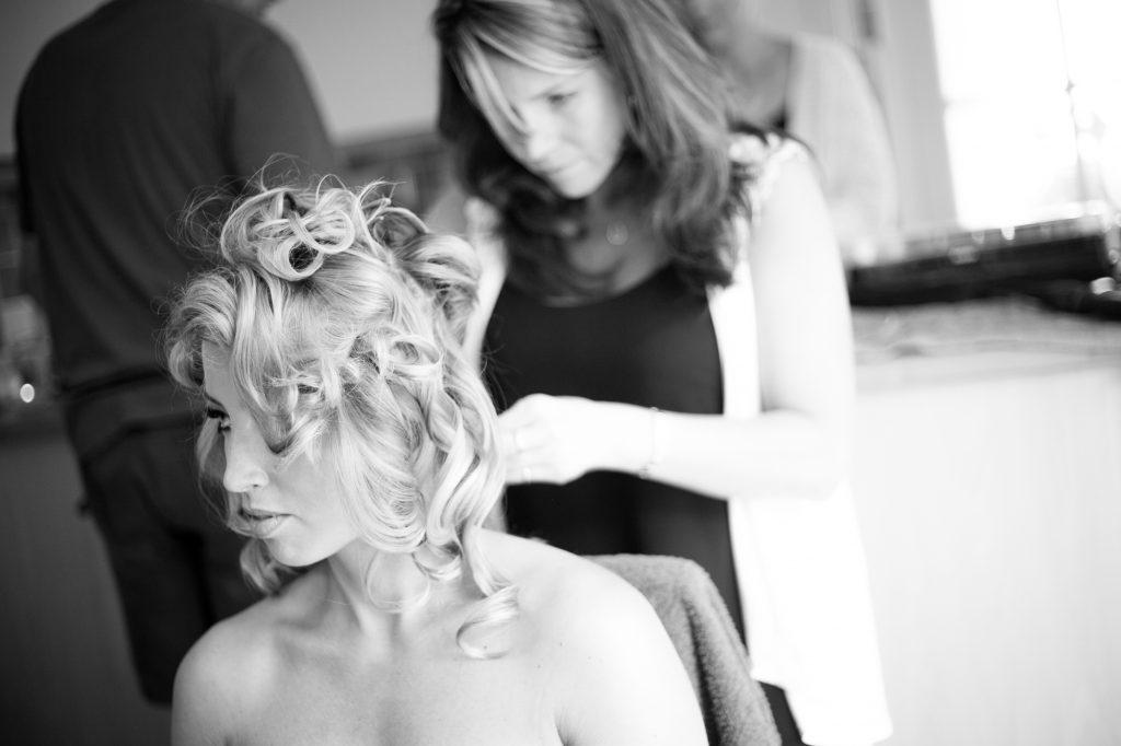 Wedding hair styling at wedding prep photography