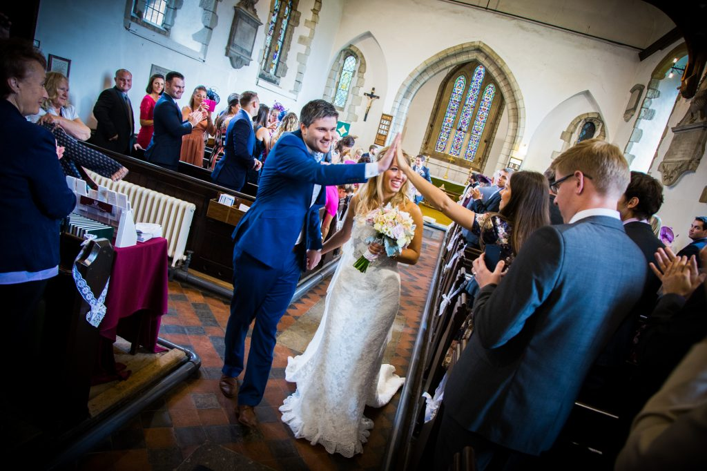 Groom high five at the end of the wedding ceremony