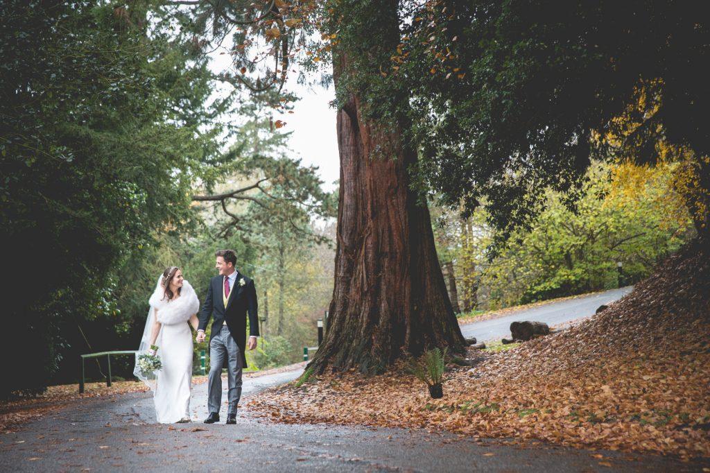 Bride and Groom portrait shot walking outside Nutfield Priory.