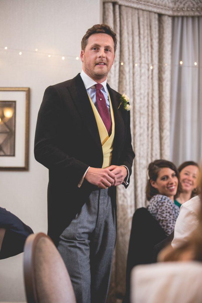 Wedding speeches photo groom giving speech.