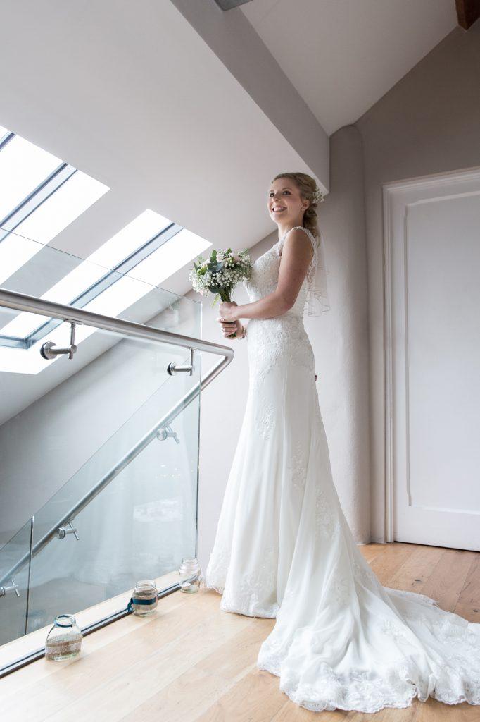 Bride in wedding dress at balcony at Trevenna wedding venue