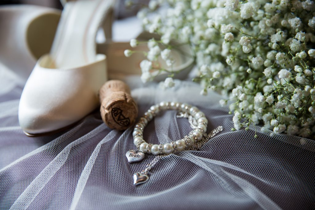 Wedding styling photo with shoes and jewellery at wedding preparation