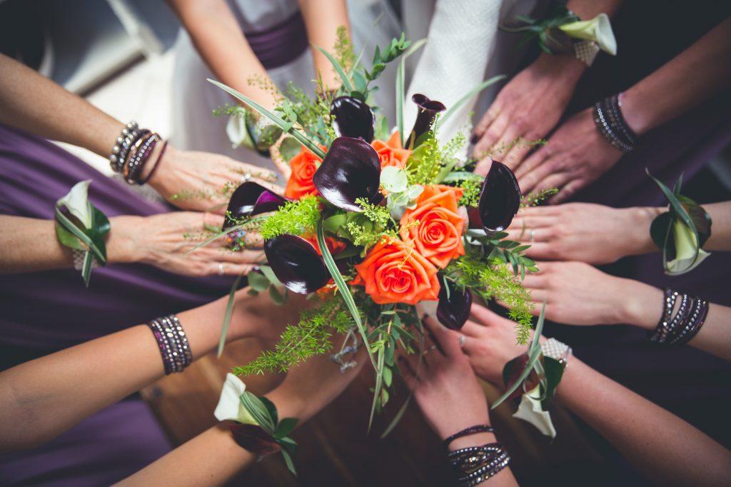 Wedding party team photo hands in