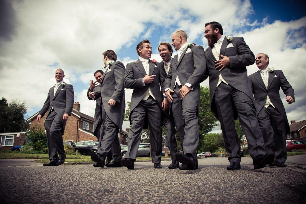 Fun groomsman photo wedding party walking