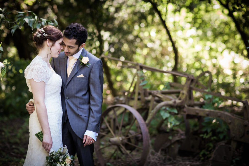 Bride and groom portrait after wedding ceremony countryside field