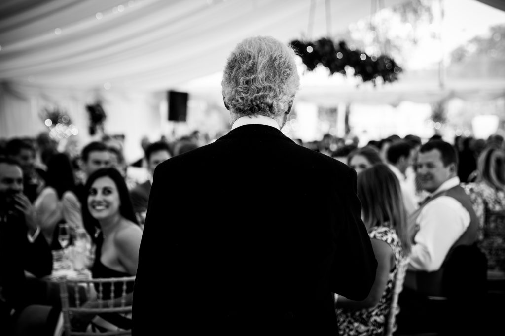 Wedding speeches photo father of the bride speech from the back.
