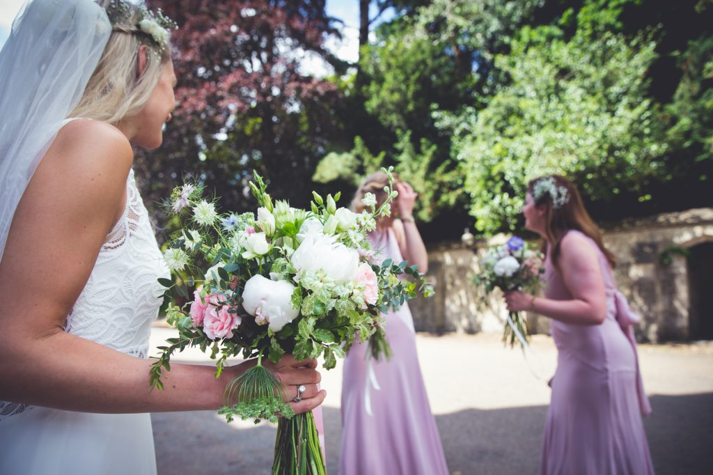 Bridal party and bouquet outside Nutfield priory