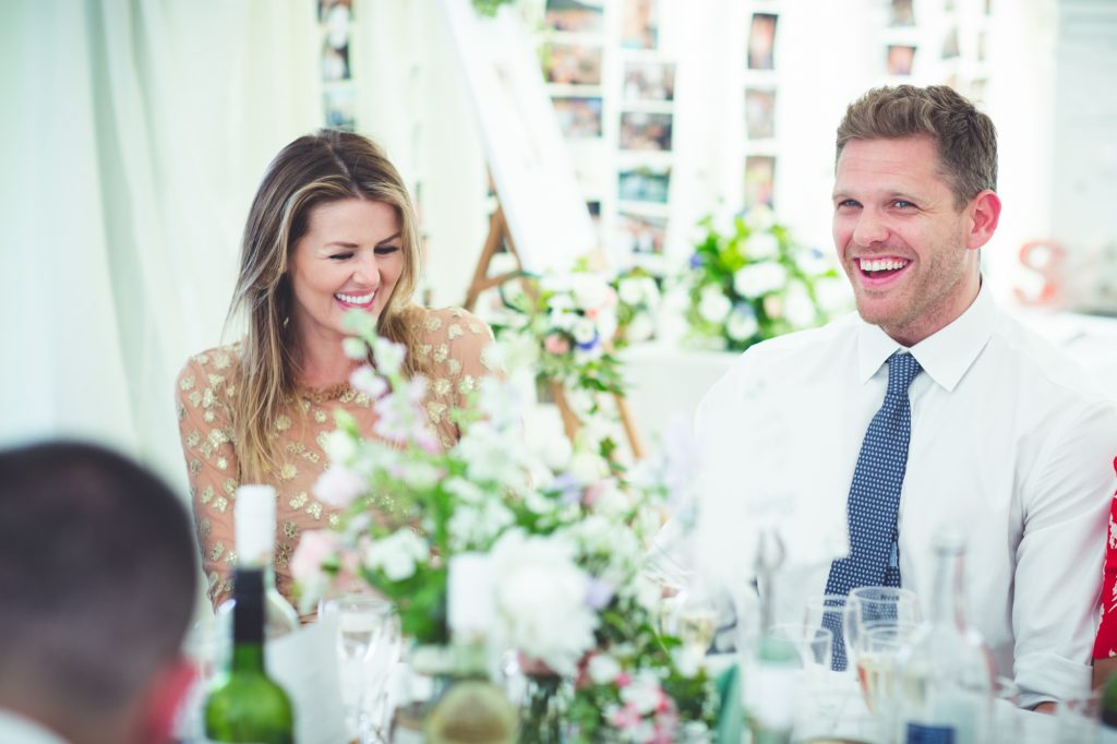 Guests laughing at the wedding speeches.