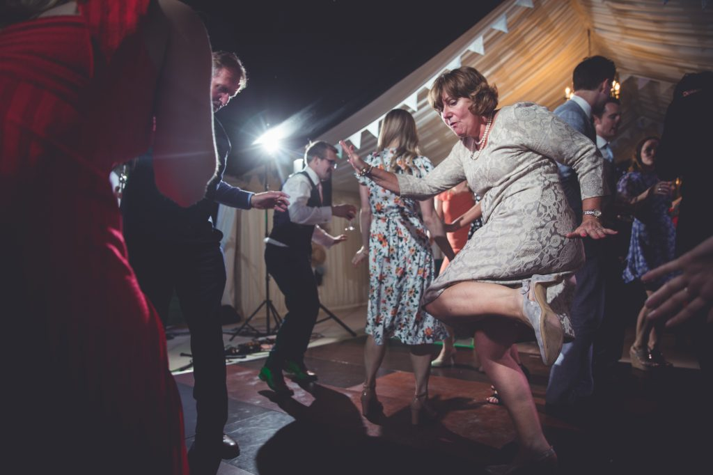 Guests dancing at the end of the wedding day, fun photo.