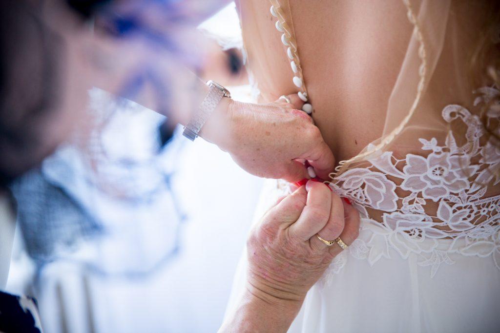 Putting the wedding dress on photo
