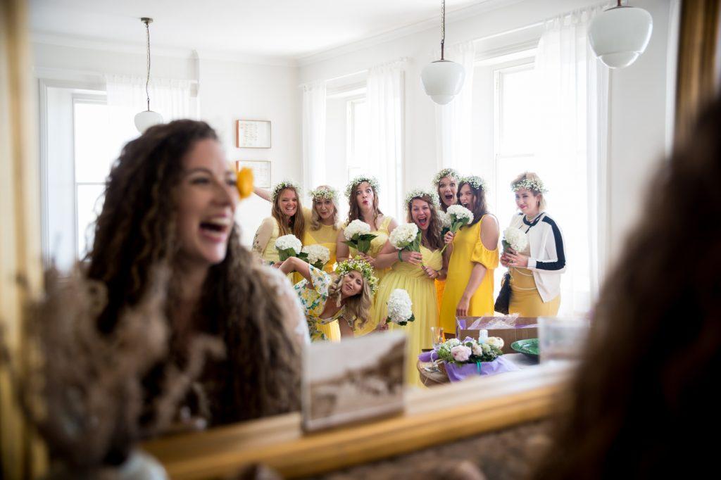 Fun bridal party photo in a mirror