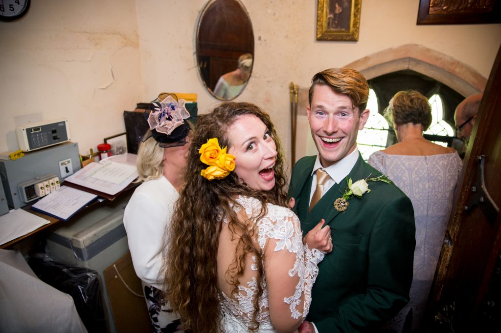 Bride and groom fun photo after wedding ceremony