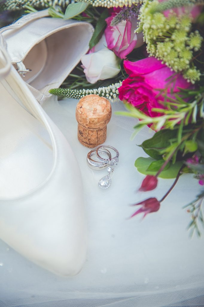 Wedding styling photo with shoes and wedding band