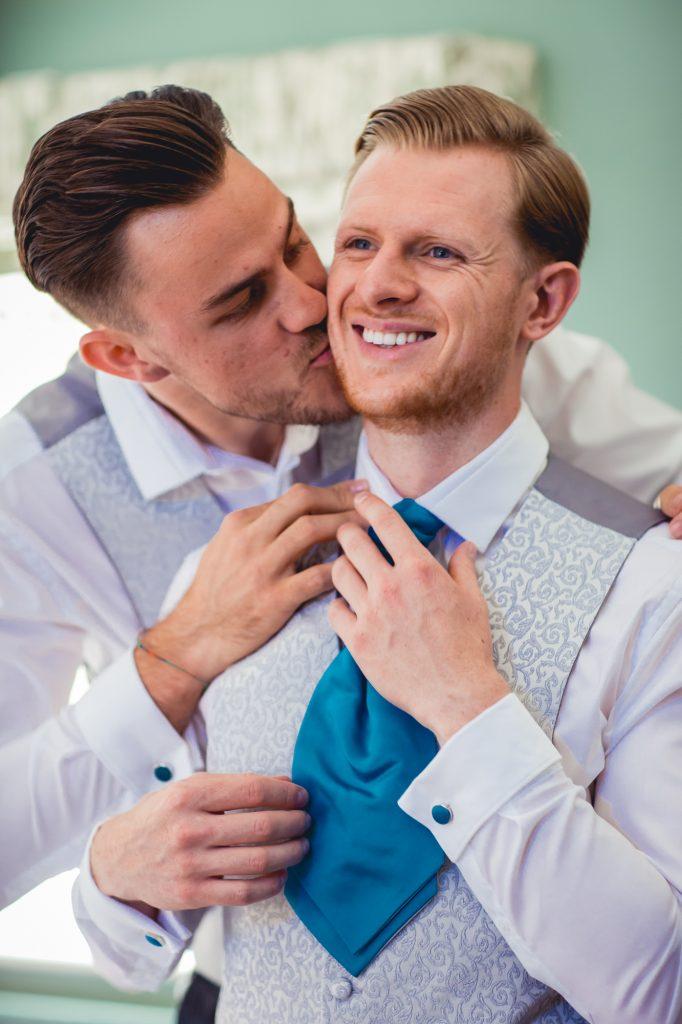 Fun groomsman photo at wedding preparation